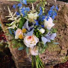 Tied bouquet with blue delphinium