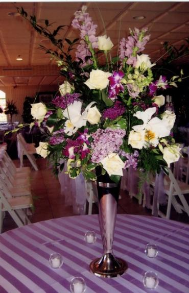 Purple and Lilac Centerpiece with Cateleya Orchids